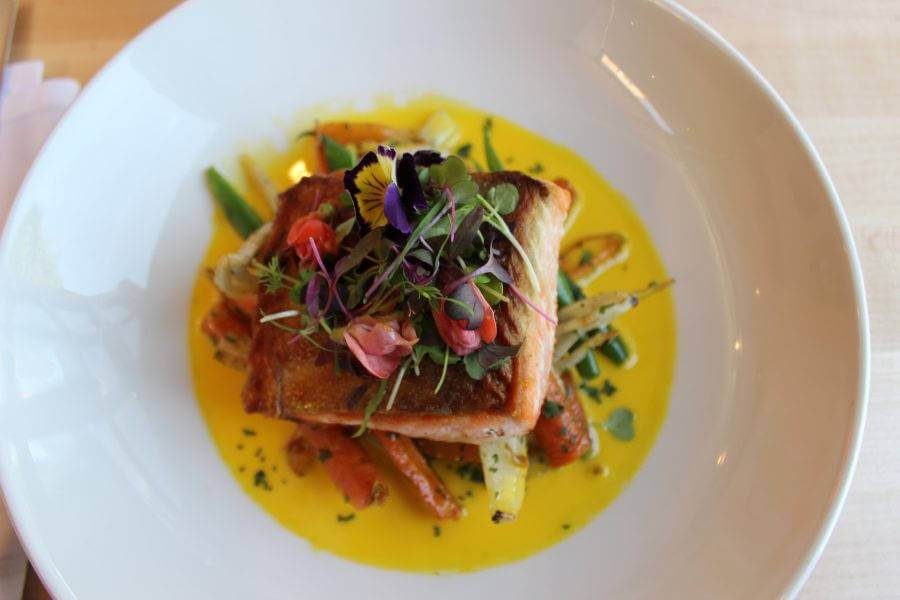 A beautiful salmon and vegetable dish at award-winning Blackbelly in Boulder