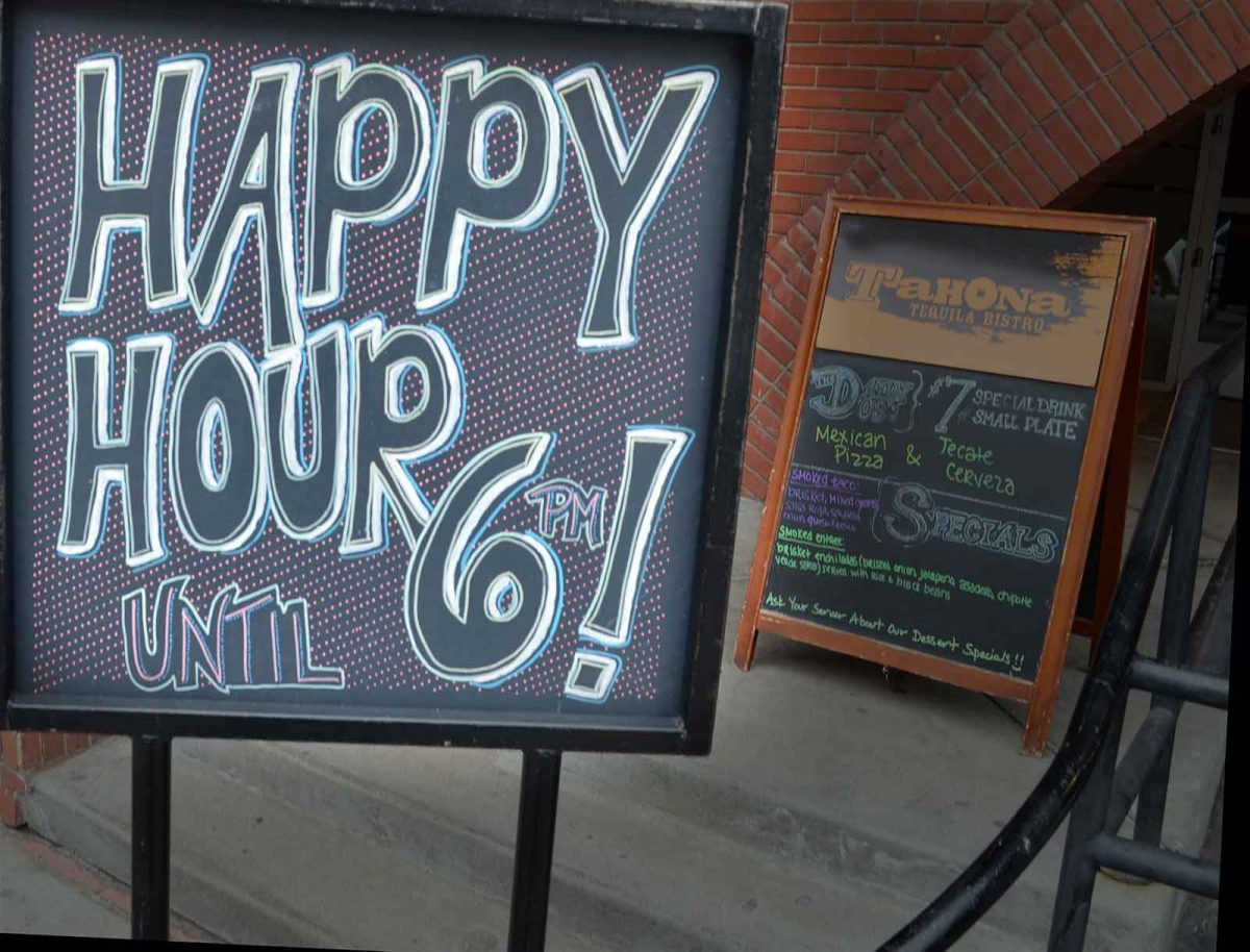 Happy Hour Sign in front of Tahona