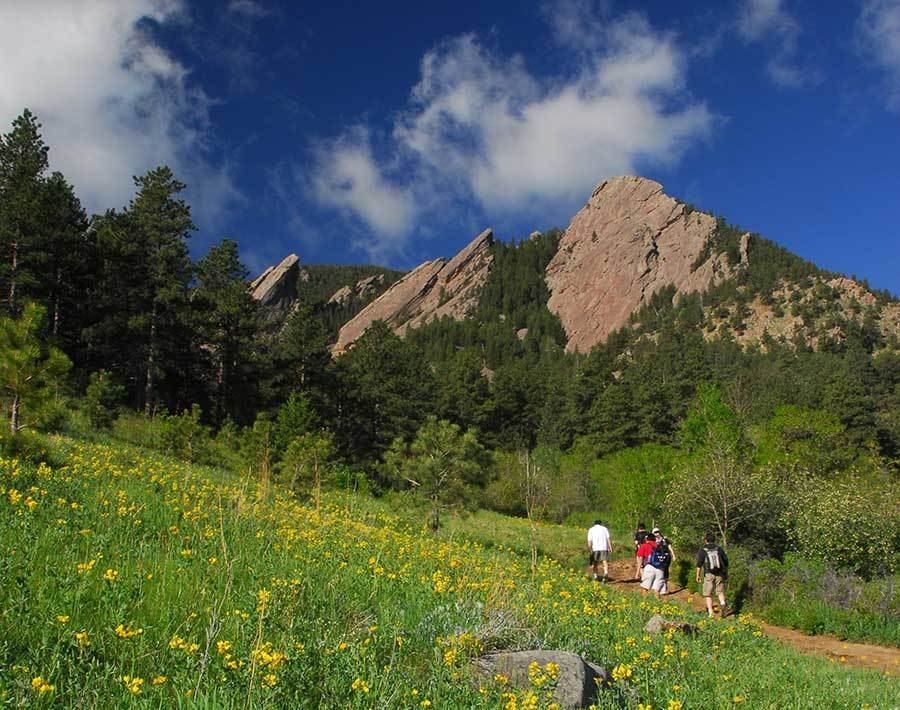Hikers head towards Flatirons