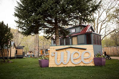 Wee Casa sign in front of tiny home
