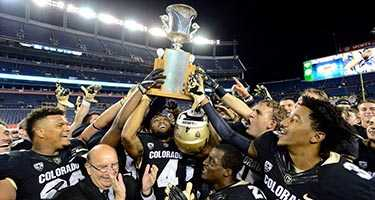 CU football team with trophy
