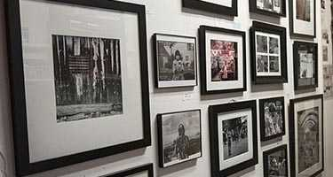 A wall of framed art in North boulder