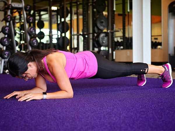 Woman doing a plank at Anytime Fitness