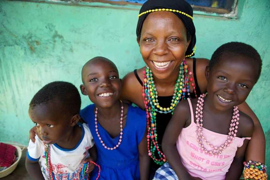 Woman Wearing Beads With Children