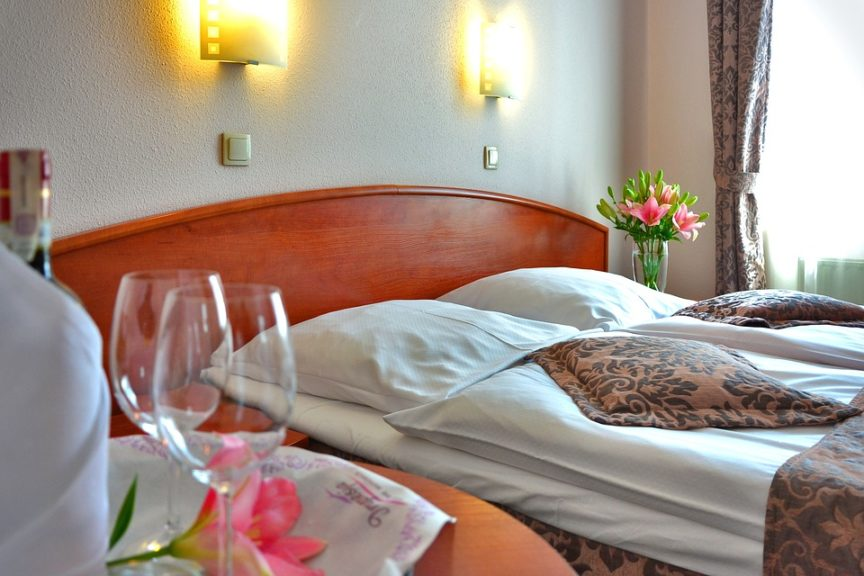 hotel room with wine glasses and flowers