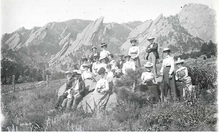 Group of hikers in front of Flatirons