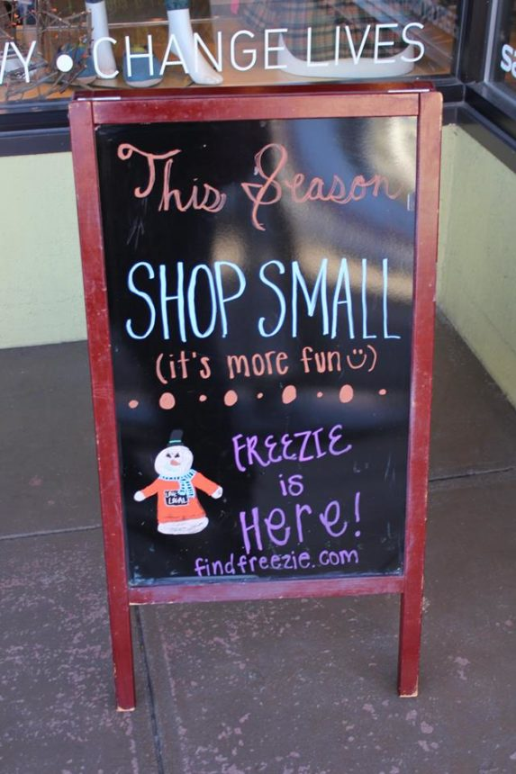 A sign in downtown Boulder supporting small businesses